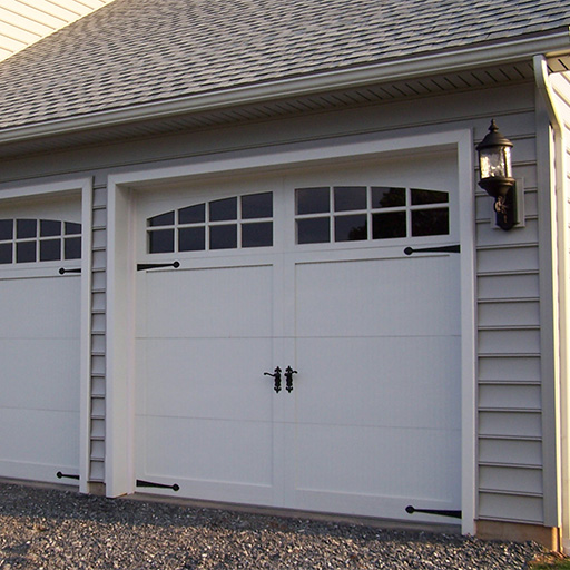 Advantage estate insulated steel garage doors for Build carriage garage doors